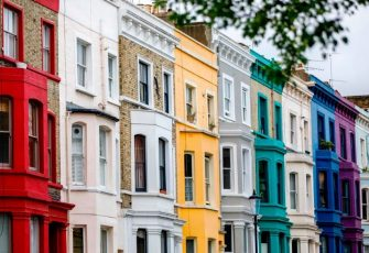 A row of painted houses is pictured in the Notting Hill district of west London, on August 8, 2017. Last week, The Bank of England cut its UK growth forecasts with governor Mark Carney warning that high inflation triggered by a Brexit-fuelled slump in the pound had hurt consumer spending. / AFP PHOTO / Tolga Akmen        (Photo credit should read TOLGA AKMEN/AFP via Getty Images)