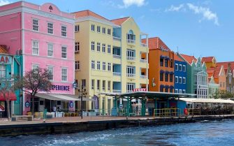View of pastel colored colonial buildings on the waterfront of old town Willemstad, Curacao, in the Dutch Caribbean, on March 5, 2020. (Photo by Daniel SLIM / AFP) (Photo by DANIEL SLIM/AFP via Getty Images)