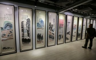 """Qi Baishi's """"Twelve Screens of Landscapes"""" displayed at the Poly Auction spring sales 2017 media preview at One Pacific Place in Admiralty. 24NOV17 SCMP / Felix Wong"""