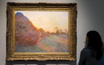 epa07544875 The 1890 painting 'Meules' by Claude Monet, estimated to sell for over 55 million USD, is on display during a preview of upcoming 'Impressionist and Modern Art' and 'Contemporary Art' auctions at Sotheby's in New York, New York, USA, 03 May 2019. The auctions take place in the middle of May.  EPA/JUSTIN LANE