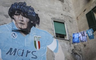 NAPLES, ITALY - 2020/11/30: A detail of Maradona's mural and three shirts with number 10, two of the SSc Napoli team and one el Tem of the Argentine national team in the Spanish Quarter, in tribute to Diego Armando Maradona a week after his death. (Photo by Roberta Basile/KONTROLAB/LightRocket via Getty Images)