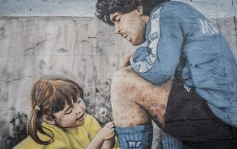 NAPLES, ITALY - JUNUARY 8 - A mural depicting Argentine footballer Diego Armano Maradona outside the former Centro Sportivo Paradiso in Naples' Soccavo, January 4, 2021. Argentinean footballer Diego Armando Maradona was an important figure for the Neapolitan people. (Photo by Manuel Dorati/NurPhoto via Getty Images)