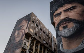 NAPLES, ITALY - JUNUARY 8 - The mural by Neapolitan artist Jorit on the wall of a council building in San Giovanni a Tettuccio in Naples depicts Argentinean footballer Diego Armando Maradona (R) and Scugnizzo Nicol (L), January 4, 2021. (Photo by Manuel Dorati/NurPhoto via Getty Images)