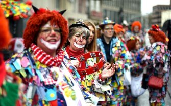"""COLOGNE, GERMANY - FEBRUARY 07: Carnival reveller celebrate during a carnival parade called """"Schull- un Veedelszoech"""" as part of the carnival season on February 7, 2016 in Cologne, Germany. Carnival partying and parades, a centuries-old tradition in western and southwestern Germany, traditionally occurs in February and runs until Ash Wednesday, the start of Lent, and culminates in Rose Monday parades and festivities. Police are on added alert this year, particularly in Cologne, due to the New Year`s Eve sex attacks on women that have been attributed to gangs of North African men, predominantly from Algeria and Morocco.  (Photo by Volker Hartmann/Getty Images)"""