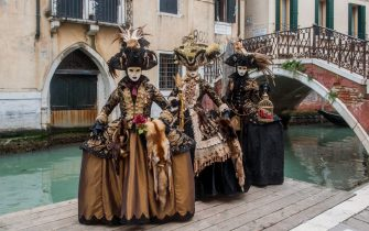 VENICE, ITALY - FEBRUARY 08:  People wearing carnival costumes pose on February 8, 2018 in Venice, Italy. The theme for the 2018 edition of Venice Carnival is 'Playing' and will run from 27 January to 13 February.  (Photo by Awakening/Getty Images)