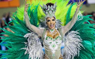 RIO DE JANEIRO, BRAZIL - MARCH 03: A member of Imperio Serrano Samba School gesturest during their parade at 2019 Brazilian Carnival at Sapucai Sambadrome on March 03, 2019 in Rio de Janeiro, Brazil. Rio's two nights of Carnival parades began today in a burst of fireworks and to the cheers of thousands of tourists and locals who have previously enjoyed street celebrations (known as 'blocos de rua') all around the city. (Photo by Buda Mendes/Getty Images)