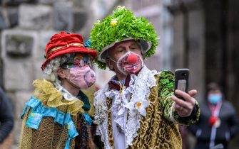 COLOGNE, GERMANY - FEBRUARY 15: A lone pair of carnival enthusiasts take a selfie on Rose Monday, the day that is normally the height of Germany's carnival season, during the second wave of the coronavirus pandemic on February 15, 2021 in Cologne, Germany. Carnival celebrations have been cancelled nationwide this year as part of ongoing lockdown measures. (Photo by Lukas Schulze/Getty Images)