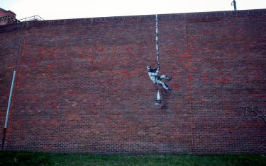 An artwork which has appeared on the wall of the former prison in Reading, Berkshire. Picture date: Monday March 1, 2121. PA Photo. Although its has not been officially claimed as the work of Banksy, the picture bares a resemblance to the artists other works. Photo credit should read: Steve Parsons/PA Wire (Photo by Steve Parsons/PA Images via Getty Images)