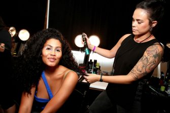 NEW YORK, NEW YORK - SEPTEMBER 07:  Leyna Bloom prepares backstage for TRESemme x Chromat during NYFW on September 07, 2019 in New York City. (Photo by Astrid Stawiarz/Getty Images for TRESemme)