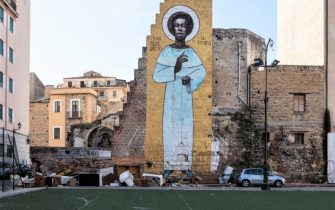 PALERMO, ITALY - NOVEMBER 21: A giant mural depicting Benedict the Moor, one of Palermo's patron, is pictured in the area of Ballaro market on November 21, 2019 in Palermo, Italy. (Photo by Emanuele Cremaschi/Getty Images)