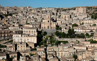 A picture taken on July 31, 2017 shows the Cathedral of San Giorgio (C), in Modica, Sicily. - Modica is part of the Italy's UNESCO Heritage Sites. (Photo by ludovic MARIN / AFP)        (Photo credit should read LUDOVIC MARIN/AFP via Getty Images)