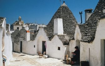 Trulli (traditional dry stone huts with a conical roof) in Alberobello (UNESCO World Heritage List, 1996), Apulia, Italy.
