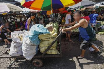 epa06622440 A worker pushes a cart of waste from agriculture products at a market in Quezon City, east of Manila, Philippines, 23 March 2018. The World Bank on 23 March released a report titled 'The Challenge of Agricultural Pollution: Evidence from China, Vietnam and the Philippines' to lay out potential measures for cleaner and safer agriculture. Findings of the report reveal that while agriculture increases food security in East Asia, mismanaged agricultural production contributes to environmental degradation and reduced quality and safety of food.  EPA/ROLEX DELA PENA