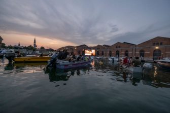 VENICE, ITALY - JULY 24: Venetians by boat watch the film at the Arsenale on July 24, 2021 in Venice, Italy. The summer of 2021 will see the second edition of Cinema Barch-in, a real aquatic drive-in, to which you land by boat to watch a movie comfortably on the water. (Photo by Stefano Mazzola/Awakening/Getty Images)