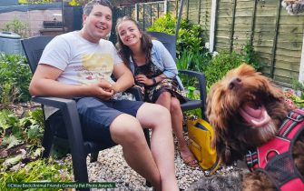 The Comedy Pet Photography Awards 2021 Chloé Beck Redditch United Kingdom Title: Hugo the Photobomber! Description: This is my best friend Faith and her husband Alex... And their cheeky Sproodle, Hugo. Faith wanted a photograph to mark a special occasion - her first outing after shielding at home for 14 months. Hugo jumped into the frame at just the right moment! He's a lockdown pup, so he hasn't quite gotten used to the excitement of being around other people yet hehe :-) Animal: Hugo the Sproodle Location of shot: My Mom's garden in Darlaston, Walsall.