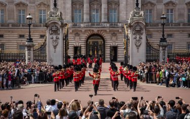 LONDON, ENGLAND - JUNE 24:  Tourists watch the Changing of the Guard at Buckingham Palace on June 24, 2015 in London, England.  The Queen may have to move out of Buckingham Palace, her official London residence, so that maintenance work with an estimated cost of £150 million GBP can be carried out. The Crown Estate, which owns property on the Queen's behalf, has announced record profits of £285m last year, a rise of 6.7%, whilst taxpayer funding of the Queen is anticipated to increase by £2m next year to £42.8m.  (Photo by Rob Stothard/Getty Images)