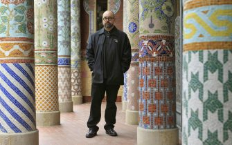 epa04085490 Spanish author Carlos Ruiz Zafon poses  during the presentation of his suite 'The Shadow of the Wind', music that the author composed while he was writing his homonymous novel, at the Music Palace in Barcelona, Spain, 18 February 2014. The suite will be premiered next 05 April 2014.  EPA/TONI ALBIR
