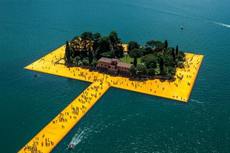 """SULZANO, ITALY - JUNE 28: Aerial view of the installation """"The Floating Piers"""" by artist Christo Vladimirov Yavachev. The work connects the village of Sulzano to the small island of Monte Isola and another very small island (São Paulo Island) on June 28, 2016 in Sulzano, Italy. Christo died on Sunday, May 31, 2020, of natural causes in his home in New York City in the United States at the age of 84. (Photo by Fabrizio Villa/Getty Images)"""