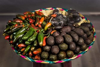 A tray with avocados and Jalapeno chili peppers is on display at the 20 de Noviembre market on February 27, 2017 in Oaxaca, Mexico. / AFP PHOTO / Omar TORRES        (Photo credit should read OMAR TORRES/AFP via Getty Images)
