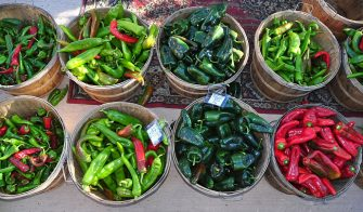 SANTA FE, NM - SEPTEMBER 21, 2013: Baskets of red and green chiles and poblano peppers for sale at the popular vegetable market in Santa Fe, New Mexico. (Photo by Robert Alexander/Getty Images)