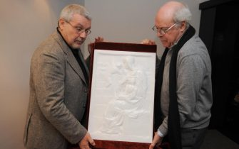 """FMR (Franco Maria Ricci)'s scientific director Flaminio Gualdoni (L) and general director Antonio Pistilli present on October 9, 2008 in Paris the marble cover of a Michelangelo monography to be sold for 100.000 euros. FMR publishing house printed only 99 copies of its """"most beautiful book of the world"""", created by thirteen craftmanshops with a marble cover, 83 original photographs by Aurelio Amendola and a text calligraphed on parchment. AFP PHOTO BORIS HORVAT (Photo credit should read BORIS HORVAT/AFP via Getty Images)"""