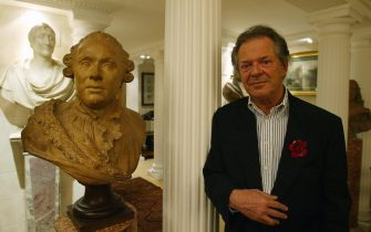 ROME, ITALY:  Renowned Italian art editor Franco Maria Ricci stands next to bust of the Duke of Wellington in his Rome appartment in this picture taken 18 March 2004. Ricci will display his private art collection of over 200 sculptures collected in 40 years in the Reggia di Colorno's castle from April 3 to July 18. AFP PHOTO/Vincenzo PINTO  (Photo credit should read VINCENZO PINTO/AFP via Getty Images)