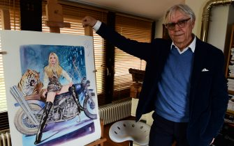 TO GO WITH AFP STORY BY PHILIP SIUBERSKI - Italian artist Milo Manara next to one of his drawing of French icon Brigitte Bardot, on May 13, 2016 in his house near Verona.   / AFP / GIUSEPPE CACACE        (Photo credit should read GIUSEPPE CACACE/AFP via Getty Images)