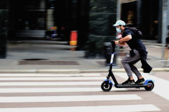 MILAN, ITALY - MAY 15:  A man wearing a protective mask rides a scooter on May 11, 2020 in Milan, Italy. Italy was the first country to impose a nationwide lockdown to stem the transmission of the Coronavirus (Covid-19), and its restaurants, theaters and many other businesses remain closed.  (Photo by Pier Marco Tacca/Getty Images)