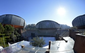 "A picture shows the auditorium Parco Della Musica designed by Italian architect Renzo Piano on January 13, 2015 in Rome. The three large concert halls are Sala Petrassi, in memory of Goffredo Petrassi, about 700 seats, sala Sinopoli, in memory of Giuseppe Sinopoli, about 1200 seats and Sala Santa Cecilia, about 2800 seats. They are structurally separated to ensure soundproofing, though joined at the base by a continuous lobby. A fourth ""concert hall"", called Cavea, is the open air theater recalling ancient Greek and Roman theaters. The auditorium inaugurated in 2002 has several nicknames such as blobs, beetles, scarabs, turtles, insect carapaces.  AFP PHOTO / ANDREAS SOLARO        (Photo credit should read ANDREAS SOLARO/AFP via Getty Images)"