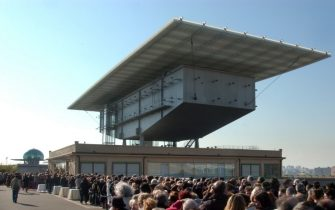 TURIN, ITALY - JANUARY 25:  Thousands of people wait to enter the funeral chamber of Fiat honorary chairman, Giovanni Agnelli, which is located on the roof of the old Fiat founding factory known as Lingotto January 25, 2003 in Turin, Italy. Agnelli, one of Europe's most influential business tycoons, died January 24, 2003 at the age of 81. The Italian industrialist, who has been credited with transforming Fiat into a global force, had been suffering from prostate cancer.  (Photo by Giuseppe Cacace/Getty Images)