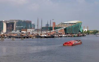 AMSTERDAM, NETHERLANDS - MAY 30: General view of the NEMO Science Museum at the Dijksgracht Canal on May 30, 2018 in Amsterdam, Netherlands. Beneath the museum's building can be found the 'IJtunnel' automobile tunnel, what connects the downtown with Nord-Amsterdam. (Photo by Laszlo Szirtesi/Getty Images)