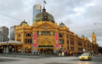 A photo taken April 2, 2010 shows Melbourne's Flinders Street Station which is the central railway station of the suburban rail network of Melbourne. It is on the corner of Flinders and Swanston Streets next to the Yarra River in the heart of the city, stretching from Swanston Street to Queen Street and covering two city blocks.  Each weekday, over 110,000 commuters and 1,500 trains pass through the station.  AFP PHOTO/William WEST (Photo credit should read WILLIAM WEST/AFP via Getty Images)