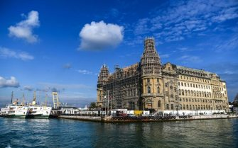 Picture taken on January 15, 2018 shows a general view of historical Haydarpasa (pronounced Haydarpasha) train station in Istanbul. Built in the first decade of the 20th century, by two German architects,  as Europes gateway to the east, the Istanbul Haydarpasa (pronounced Haydarpasha) railway station still stands proudly on the Asian side of the Bosphorus, its gothic towers looming over the waters. Since 2013, the celebrated terminus has not seen any train traffic after being shut for restoration work and a major upgrade of Turkey's railway network. / AFP PHOTO / OZAN KOSE        (Photo credit should read OZAN KOSE/AFP via Getty Images)