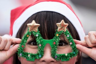 TOKYO, JAPAN - DECEMBER 22:  A participant wearing a Santa Claus costume poses for a photograph during the Tokyo Great Santa Run 2019 on December 22, 2019 in Tokyo, Japan. Over 3,000 people took part in the charity run event today. The profit of the event will be used for sick children staying in hospitals in Japan and for the clean water project in Maasai communities in Kenya.  (Photo by Tomohiro Ohsumi/Getty Images)