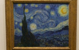 """BERLIN, GERMANY - MARCH 24:  Visitors take a look at Vincent van Gogh's """"Starry Night"""" at the MoMA exhibit, on March 24, 2004 in Berlin, Germany. The exhibit, which opened February 20 and runs through December 14, has been a tremendous success and is averaging between 5,000 and 7,000 visitors a day. Highlights of the exhibit, all of which come from the Museum of Modern Art in New York, include works by Pablo Picasso, Vincent van Gogh, Salvador Dali, Jackson Pollock and Roy Lichtenstein.  (Photo Sean Gallup/Getty Images)"""