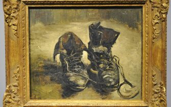 """The painting """"Shoes"""" by Dutch artist Vincent van Gogh is on display at the Wallraf-Richartz Museum in the western German city of Cologne on September 16, 2009. The painting from the year 1886 is on loan from the Van Gogh Museum in Amsterdam until January 10, 2010. AFP PHOTO DDP / HENNING KAISER GERMANY OUT (Photo credit should read HENNING KAISER/DDP/AFP via Getty Images)"""