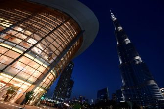 TOPSHOT - A picture taken on June 6, 2017 shows a general view of the exterior of the Dubai Opera with the Burj Khalifa nearby, in downtown Dubai in the United Arab Emirates. / AFP PHOTO / GIUSEPPE CACACE        (Photo credit should read GIUSEPPE CACACE/AFP via Getty Images)