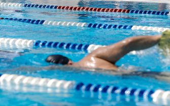 A person enjoys a swim  in the swimming  pool at the Due Ponti sports center who reopened today during the Phase Two of the coronavirus lockdown in Rome, Italy, 25 May 2020. ANSA/RICCARDO ANTIMIANI