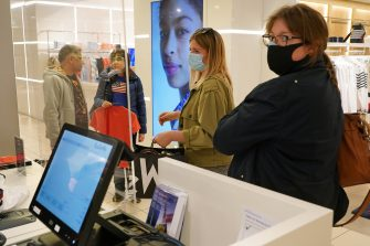 BERLIN, GERMANY - MAY 05: Shoppers, who said they did not mind being photographed, wear protective face masks at the KaDeWe department store on the first day KaDeWe fully reopened during the novel coronavirus crisis on May 05, 2020 in Berlin, Germany. Germany is carefully lifting lockdown measures nationwide in an attempt to raise economic activity.  (Photo by Sean Gallup/Getty Images)