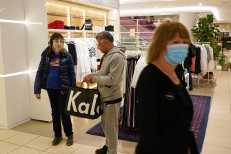 BERLIN, GERMANY - MAY 05: People wearing visors who said they did not mind being photographed shop at the KaDeWe department store on the first day KaDeWe fully reopened during the novel coronavirus crisis on May 05, 2020 in Berlin, Germany. Germany is carefully lifting lockdown measures nationwide in an attempt to raise economic activity.  (Photo by Sean Gallup/Getty Images)