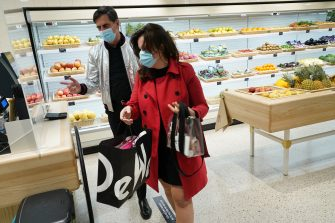 BERLIN, GERMANY - MAY 05: People wearing surgical masks who said they did not mind being photographed shop in the foods section at the KaDeWe department store on the first day KaDeWe fully reopened during the novel coronavirus crisis on May 05, 2020 in Berlin, Germany. Germany is carefully lifting lockdown measures nationwide in an attempt to raise economic activity.  (Photo by Sean Gallup/Getty Images)