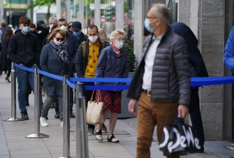 BERLIN, GERMANY - MAY 05: Shoppers wearing protective face masks wait to enter the KaDeWe department store on the first day KaDeWe fully reopened during the novel coronavirus crisis on May 05, 2020 in Berlin, Germany. Germany is carefully lifting lockdown measures nationwide in an attempt to raise economic activity.  (Photo by Sean Gallup/Getty Images)