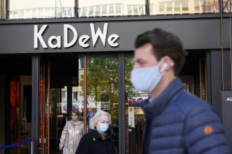 BERLIN, GERMANY - MAY 05: Shoppers wearing protective face masks emerge from the KaDeWe department store on the first day KaDeWe fully reopened during the novel coronavirus crisis on May 05, 2020 in Berlin, Germany. Germany is carefully lifting lockdown measures nationwide in an attempt to raise economic activity.  (Photo by Sean Gallup/Getty Images)