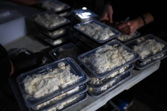 LONDON, ENGLAND - MAY 05: Portions of cream cheese are seen at a kitchen in an underground carpark run by the Hare Krishna on May 5, 2020 in London, England. The Hare Krishna are preparing and distributing meals to vulnerable people and communities across London in light of the Coronavirus pandemic. The country continues quarantine measures intended to curb the spread of Covid-19, but the infection rate is falling, and government officials are discussing the terms under which it would ease the lockdown. (Photo by Peter Summers/Getty Images)