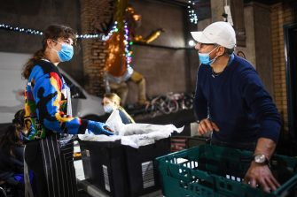 LONDON, ENGLAND - MAY 05: Volunteers wearing masks are seen putting together meals in a kitchen in an underground carpark run by the Hare Krishna on May 5, 2020 in London, England. The Hare Krishna are preparing and distributing meals to vulnerable people and communities across London in light of the Coronavirus pandemic. The country continues quarantine measures intended to curb the spread of Covid-19, but the infection rate is falling, and government officials are discussing the terms under which it would ease the lockdown. (Photo by Peter Summers/Getty Images)