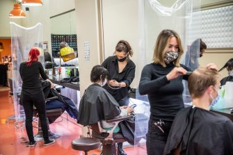 BERLIN, GERMANY - MAY 04: Hairdressers work at a hair salon that opened today for the first time since March during the novel coronavirus (Covid-19) crisis on May 4, 2020 in Berlin, Germany. Barber shops and hair salons are reopening this week nationwide as authorities carefully lift lockdown measures that had been imposed to stem the spread of the virus. (Photo by Maja Hitij/Getty Images)
