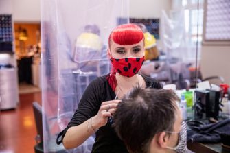 BERLIN, GERMANY - MAY 04: A hairdresser works a hair salon that opened today for the first time since March during the novel coronavirus (Covid-19) crisis on May 4, 2020 in Berlin, Germany. Barber shops and hair salons are reopening this week nationwide as authorities carefully lift lockdown measures that had been imposed to stem the spread of the virus. (Photo by Maja Hitij/Getty Images)