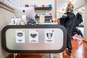 BERLIN, GERMANY - MAY 04: A hygiene instructions hang at a hair salon that opened today for the first time since March during the novel coronavirus (Covid-19) crisis on May 4, 2020 in Berlin, Germany. Barber shops and hair salons are reopening this week nationwide as authorities carefully lift lockdown measures that had been imposed to stem the spread of the virus. (Photo by Maja Hitij/Getty Images)