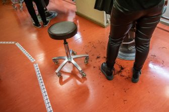 BERLIN, GERMANY - MAY 04: A tape that marks 1,5 distance is placed in a hair salon that opened today for the first time since March during the novel coronavirus (Covid-19) crisis on May 4, 2020 in Berlin, Germany. Barber shops and hair salons are reopening this week nationwide as authorities carefully lift lockdown measures that had been imposed to stem the spread of the virus. (Photo by Maja Hitij/Getty Images)