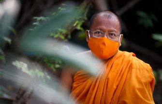 epa08401686 Thai Buddhist monk Phra Maha Pranom Dhammalangkaro wears a protective mask during an interview at Wat Chak Daeng in Samut Prakan, Thailand, 22 April 2020, 16 April 2020 (issued 05 May 2020). The traditional Buddhist temples in Thailand have adopted innovative measures like setting up sanitizing tunnels and making masks to join the fight against COVID-19. Not only have the monks added an orange mask to their attire - which has remained largely unchanged since the time of Buddha (2,500 years ago) - but also make their own sanitizers. They have also been distributing food to those who have lost their incomes due to the crisis.  EPA/DIEGO AZUBEL  ATTENTION: This Image is part of a PHOTO SET